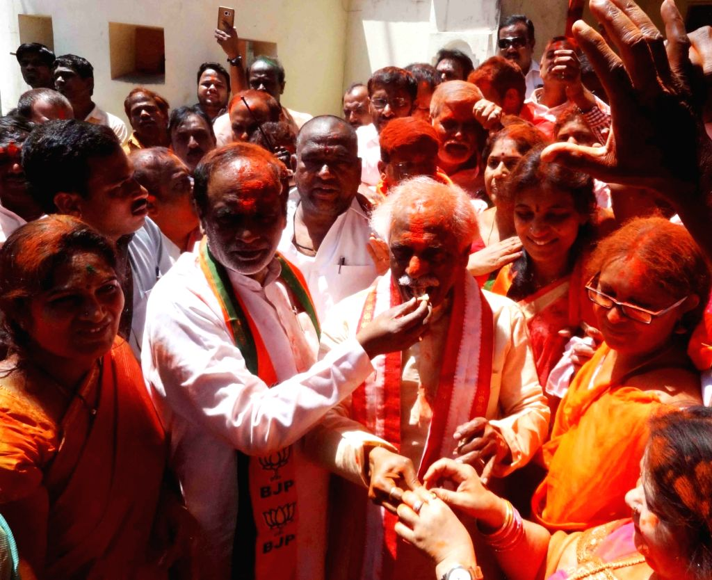 Union Minister of State for Labour and Employment Bandaru Dattareya celebrate party's performance in the assembly elections; in Hyderabad on March 11, 2017.