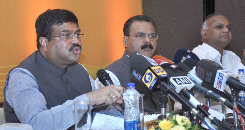 Union Minister of State for Petroleum and Natural Gas Dharmendra Pradhan addresses a press conference after inaugurating the Discovered Small Fields Bid Round 2016, in Guwahati on June 25, ...