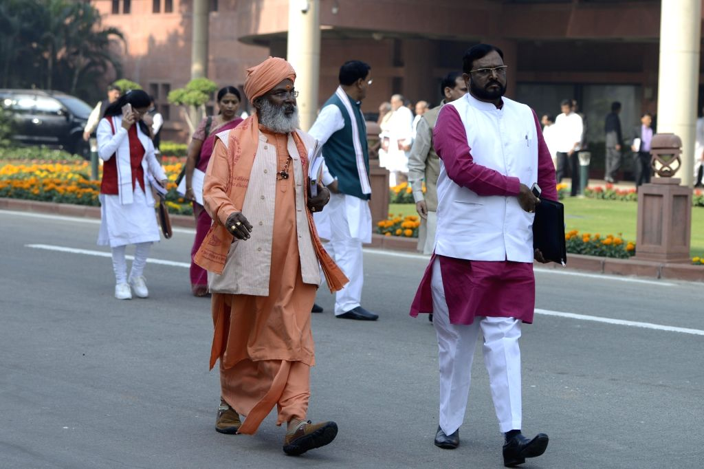 Union Minister of State for Social Justice Ramdas Athawale and BJP MP Sakshi Maharaj come out after BJP Parliamentary Party meeting at Parliament in New Delhi on Nov 29, 2016.
