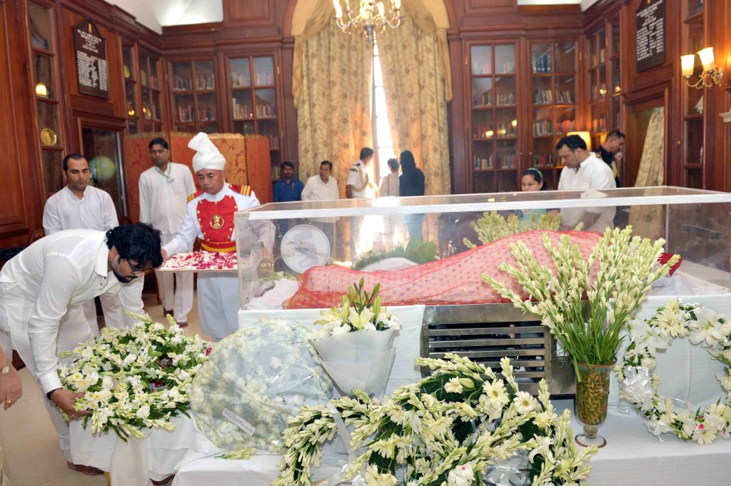 Union Minister of State for Urban Development Babul Supriyo pays tribute to the mortal remains of President Pranab Mukherjee's wife Suvra at Rashtrapati Bhawan on Aug 18, 2015. - Pranab Mukherjee