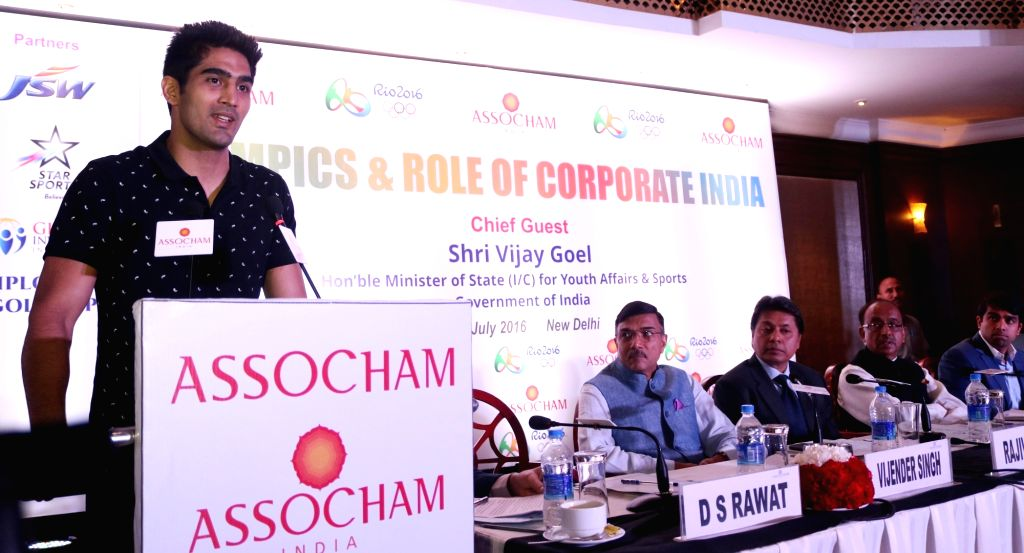 """Union minister of state for Youth and Sports, Vijay Goel, Indian pro Boxer Vijender Singh, addressing a program on """"Olympics & Role of corporate India"""" in New Delhi, on July ... - Vijender Singh"""