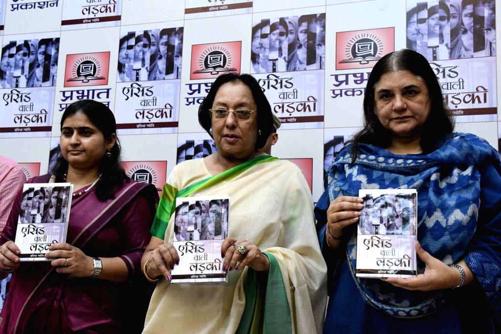 "Union Minister of Women and Child Development Maneka Gandhi and BJP MP Najma Heptulla at the launch of Partibha Jyoti's bookl ""Acid Wali Ladki"" in New Delhi, on Oct 7, 2016. - Najma Heptulla and Development Maneka Gandhi"