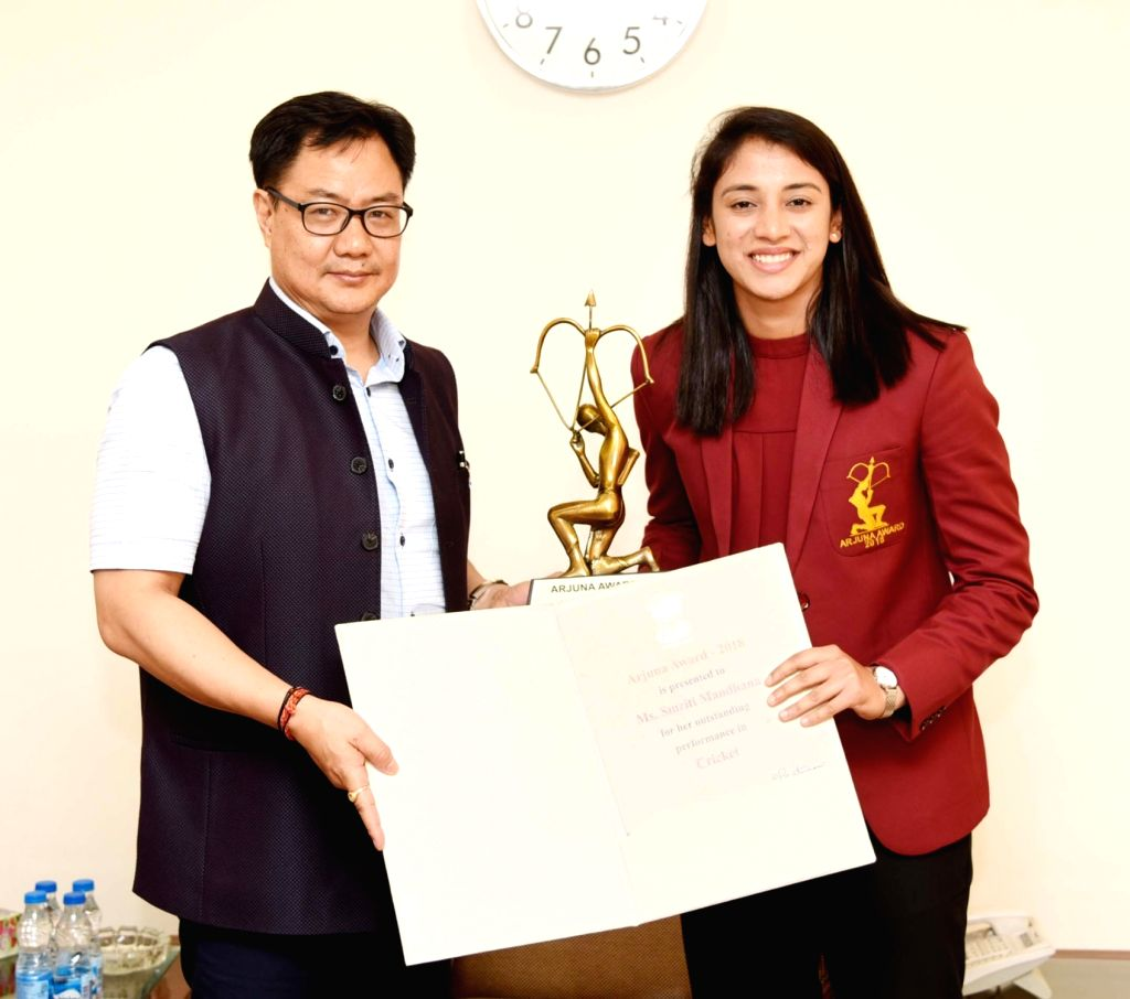 Union Minister of Youth Affairs and Sports Kiren Rijiju confers the Arjun Award to Smriti Mandhana (Cricket), in New Delhi on July 16, 2019.