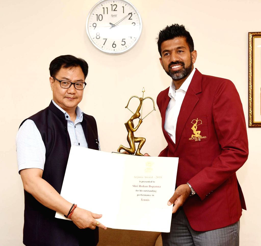Union Minister of Youth Affairs and Sports Kiren Rijiju confers the Arjun Award to Rohan Bopanna (Tennis), in New Delhi on July 16, 2019. - Rohan Bopanna