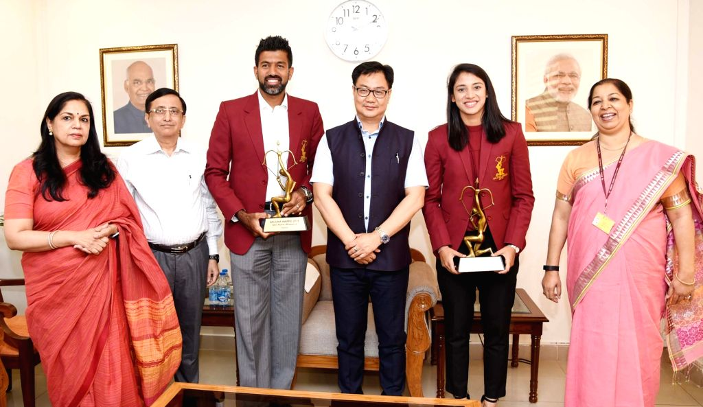 Union Minister of Youth Affairs and Sports Kiren Rijiju conferred the Arjun Awards to Smriti Mandhana (Cricket) and Rohan Bopanna (Tennis), in New Delhi on July 16, 2019. - Rohan Bopanna