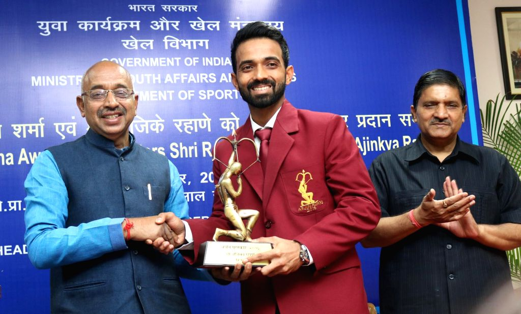 Union Minister of Youth Affairs and Sports Vijay Goel felicitates Indian cricketer Ajinkya Rahane with Arjuna Award during a programme in New Delhi on Sept 16, 2016.