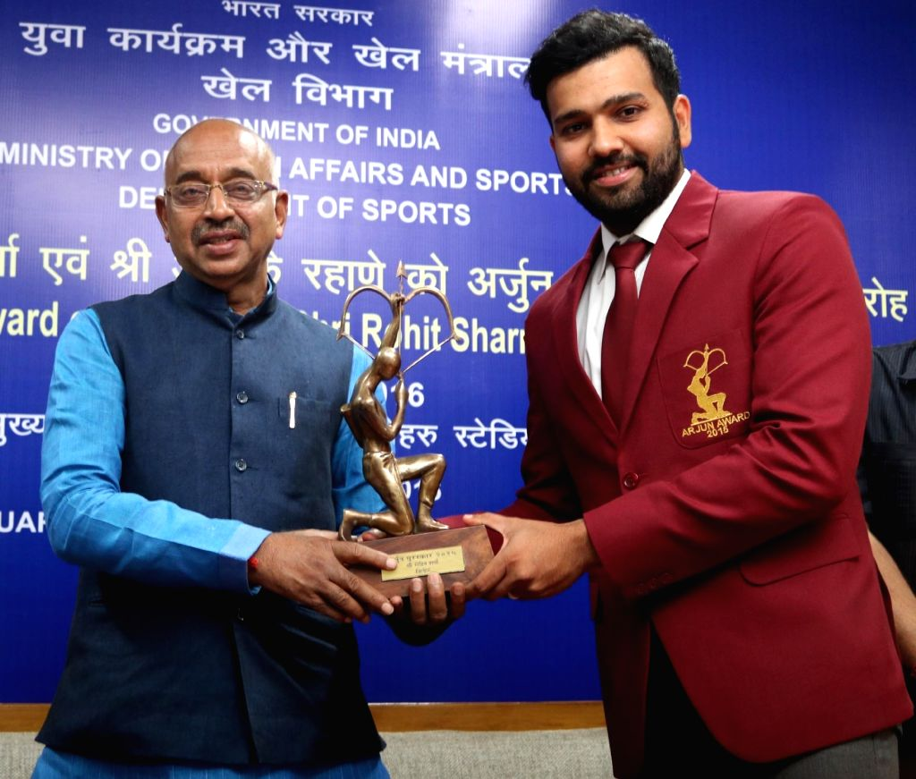Union Minister of Youth Affairs and Sports Vijay Goel felicitates Indian cricketer Rohit Sharma with Arjuna Award during a programme in New Delhi on Sept 16, 2016. - Rohit Sharma