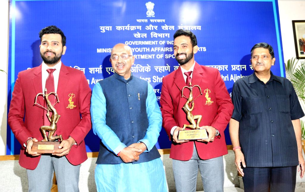 Union Minister of Youth Affairs and Sports Vijay Goel, Indian cricketers Rohit Sharma and Ajinkya Rahane during a programme organised to felicitate them with Arjuna Award in New Delhi on ... - Rohit Sharma