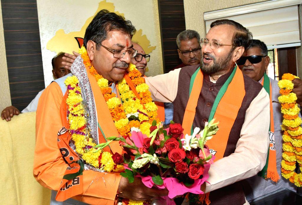 Union Minister Prakash Javadekar greets BJP leader Satish Poonia after he took charge as the party's Rajasthan unit President in Jaipur on Oct 8, 2019. - Prakash Javadekar
