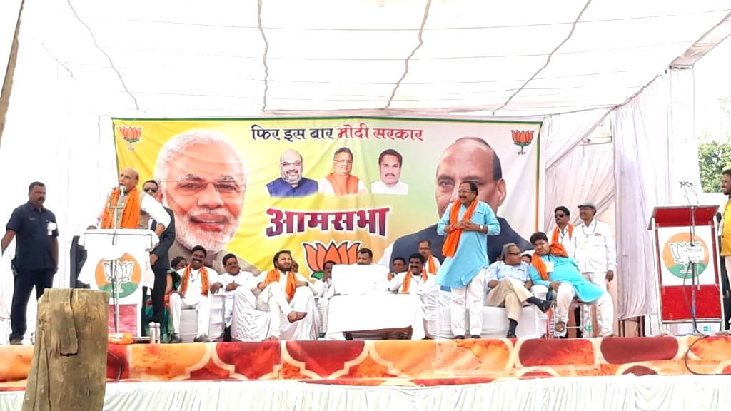 Union Minister Rajnath Singh addresses a public rally at Basna in Mahasamund district of Chhattisgarh, on April 11, 2019. - Rajnath Singh