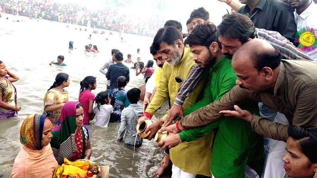 Union Minister Ram Kripal Yadav performs rituals at the banks of Ganga river during 'Chaiti Chhath' Puja celebrations in Patna, on April 12, 2019. - Ram Kripal Yadav