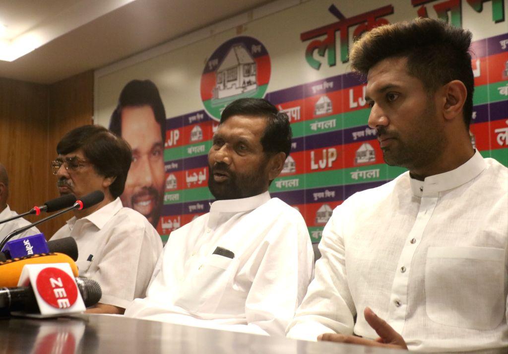 Union Minister Ram Vilas Paswan accompanied by his son and Lok Janshakti Party leader Chirag Paswan, addresses a press conference in New Delhi, on April 29, 2019. - Ram Vilas Paswan