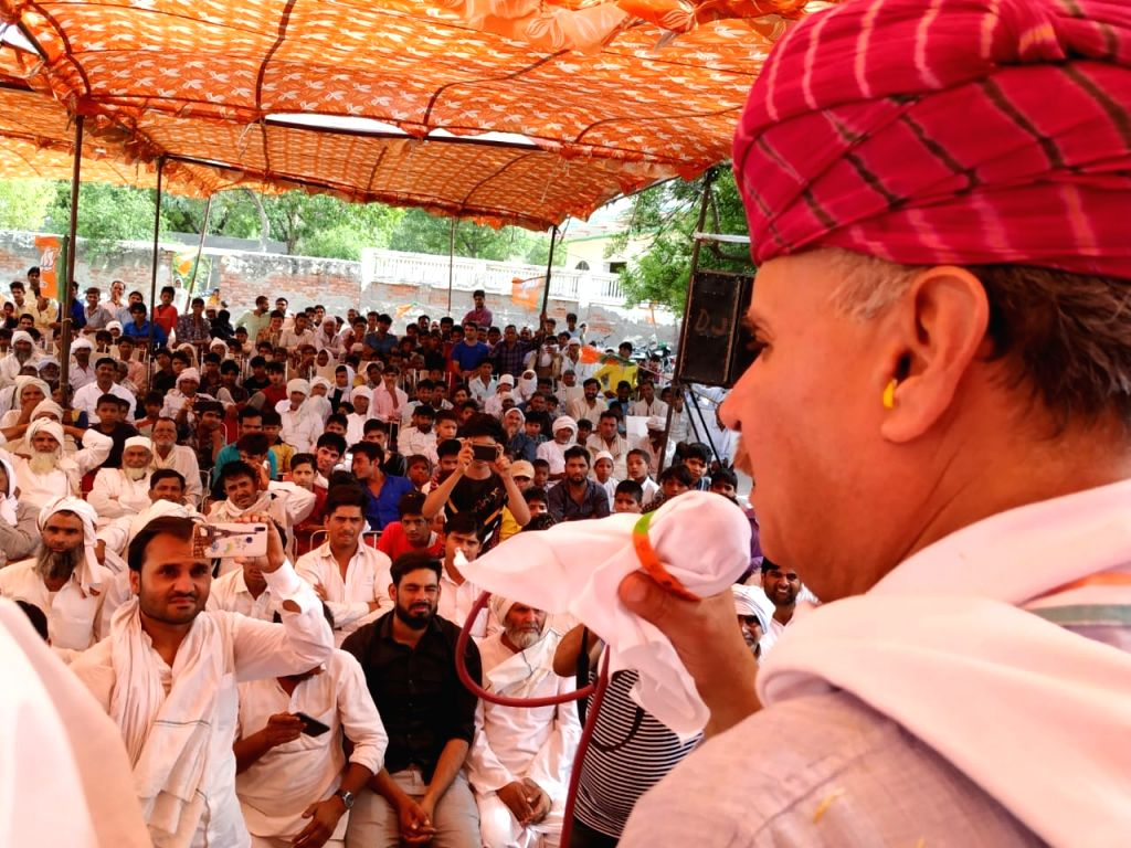 Union Minister Rao Inderjit Singh addresses during a rally in Mewat, Haryana on April 27, 2019. - Rao Inderjit Singh