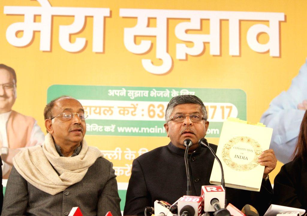 Union Minister Ravi Shankar Prasad accompanied by BJP leader Vijay Goel, addresses a press conference in New Delhi on Jan 27, 2020. - Ravi Shankar Prasad