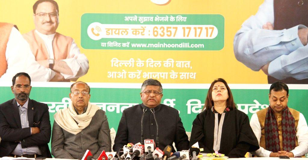 Union Minister Ravi Shankar Prasad accompanied by BJP leaders Vijay Goel, Meenakshi Lekhi and Sambit Patra, addresses a press conference in New Delhi on Jan 27, 2020. - Ravi Shankar Prasad
