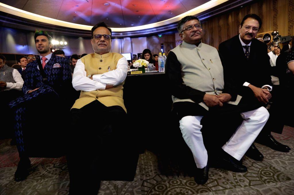 Union Minister Ravi Shankar Prasad, Finance Secretary Hasmukh Adhia and actor Ranveer Singh at India Business er Awards in New Delhion April 6, 2018. - Ravi Shankar Prasad and Ranveer Singh