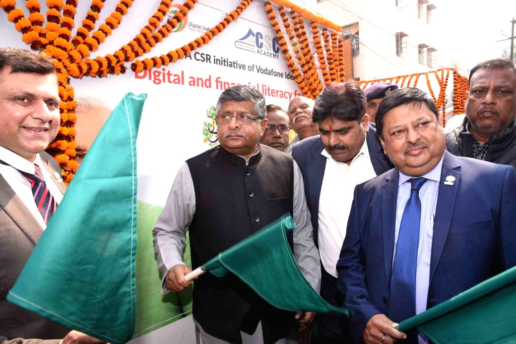 Union Minister Ravi Shankar Prasad flags off mobile vans to create awareness among people about the 'Digital and financial literacy for everyone' initiative, in Patna on Feb 9, 2020. - Ravi Shankar Prasad
