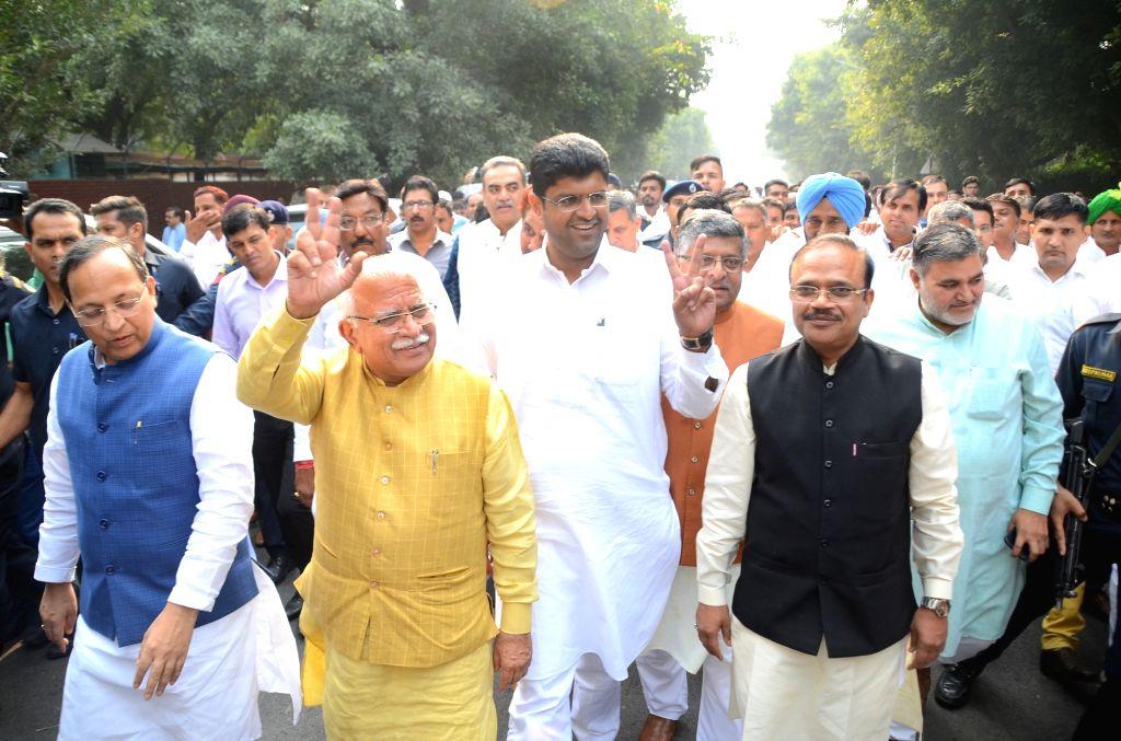 Union Minister Ravi Shankar Prasad, incumbent Haryana Chief Minister Manohar Lal Khattar, Jannayak Janata Party (JJP) chief Dushyant Chautala and BJP National General Secretary Arun Singh ... - Ravi Shankar Prasad and Manohar Lal Khattar