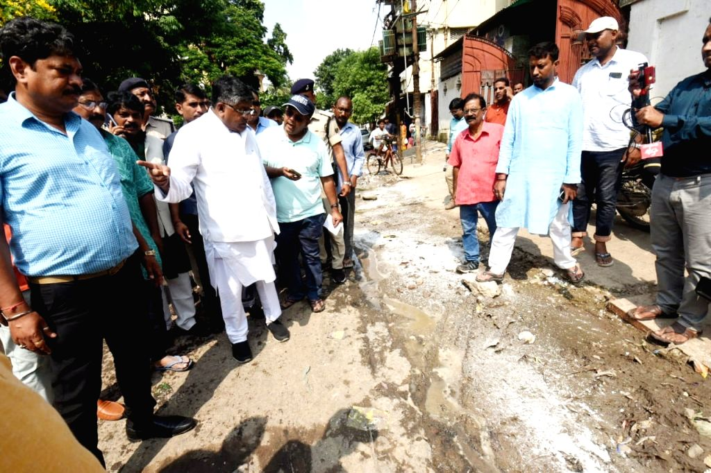 Union Minister Ravi Shankar Prasad takes stock of the situation of water accumulation on roads with potholes amidst fears of Dengue fever outbreak in Bihar; in Patna on Oct 9, 2019. - Ravi Shankar Prasad