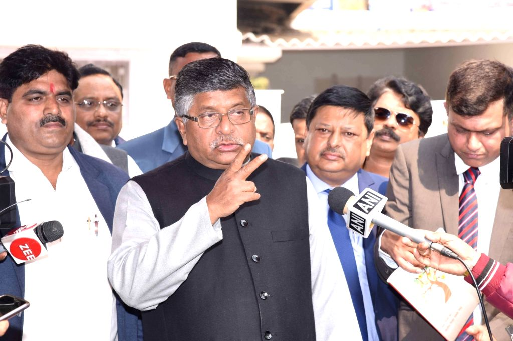 Union Minister Ravi Shankar Prasad talks to the media personnel at the flagging off ceremony of mobile vans to create awareness among people about the 'Digital and financial literacy for ... - Ravi Shankar Prasad