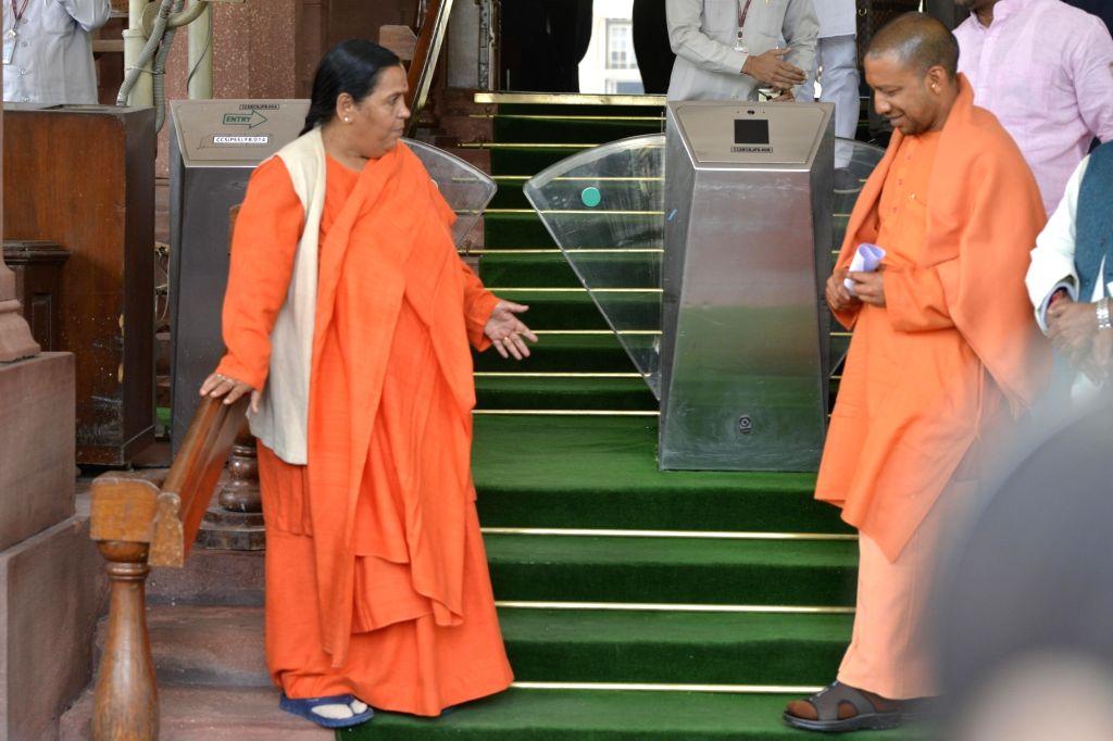 Union Minister Uma Bharti and BJP MP Yogi Adityanath at Parliament in New Delhi on Feb 15, 2017. - Uma Bharti