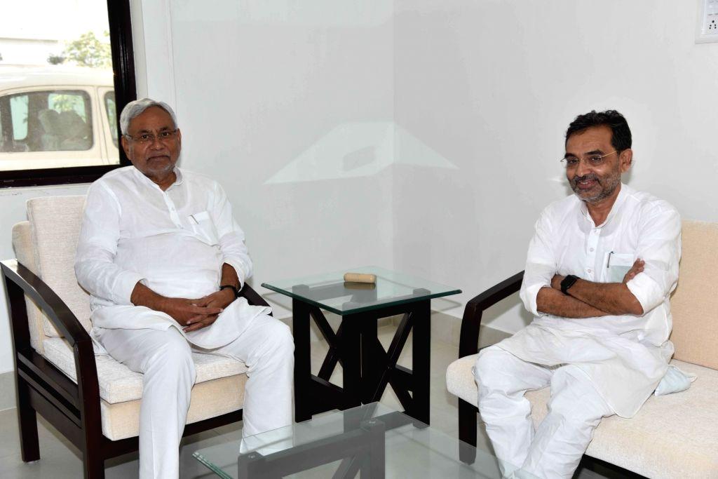 Union Minister Upendra Kushwaha calls on Bihar Chief Minister Nitish Kumar in Patna, on May 25, 2018. - Upendra Kushwaha and Nitish Kumar