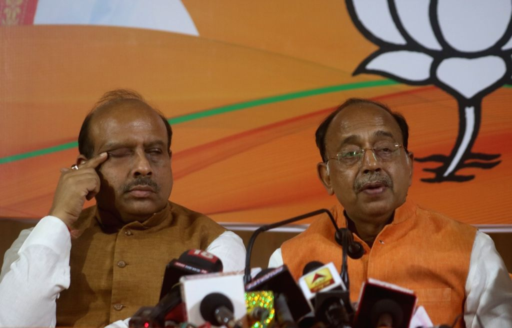 Union Minister Vijay Goel accompanied by BJP leader Vijender Gupta, addresses a press conference in New Delhi on May 11, 2019. - Vijay Goel and Vijender Gupta