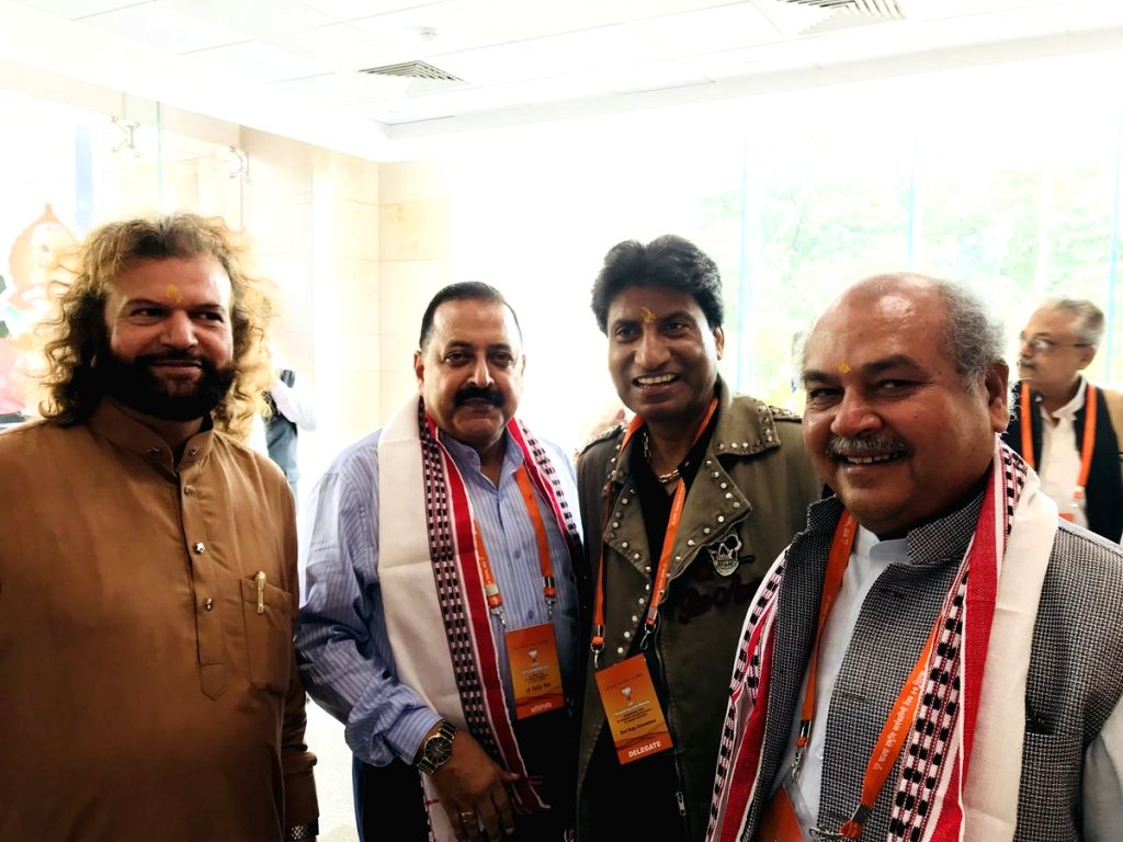 Union Ministers and BJP leaders Jitendra Singh and Narendra Singh Tomar and party leaders Raju Srivastava and Hans Raj Hans arrive to attend the party's two-day National Executive meeting, ... - Jitendra Singh and Narendra Singh Tomar