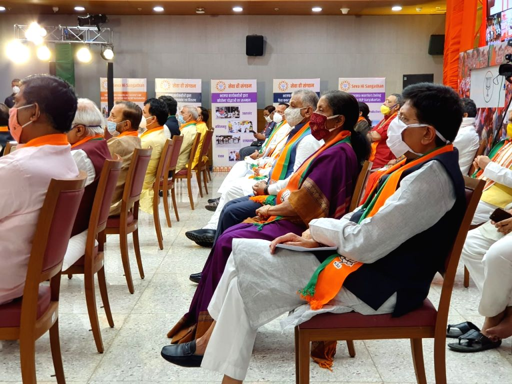 Union Ministers and BJP leaders listen to Prime Minister Narendra Modi's address as he reviews the relief work done by BJP workers during corona crisis through video conferencing, in New ... - Narendra Modi