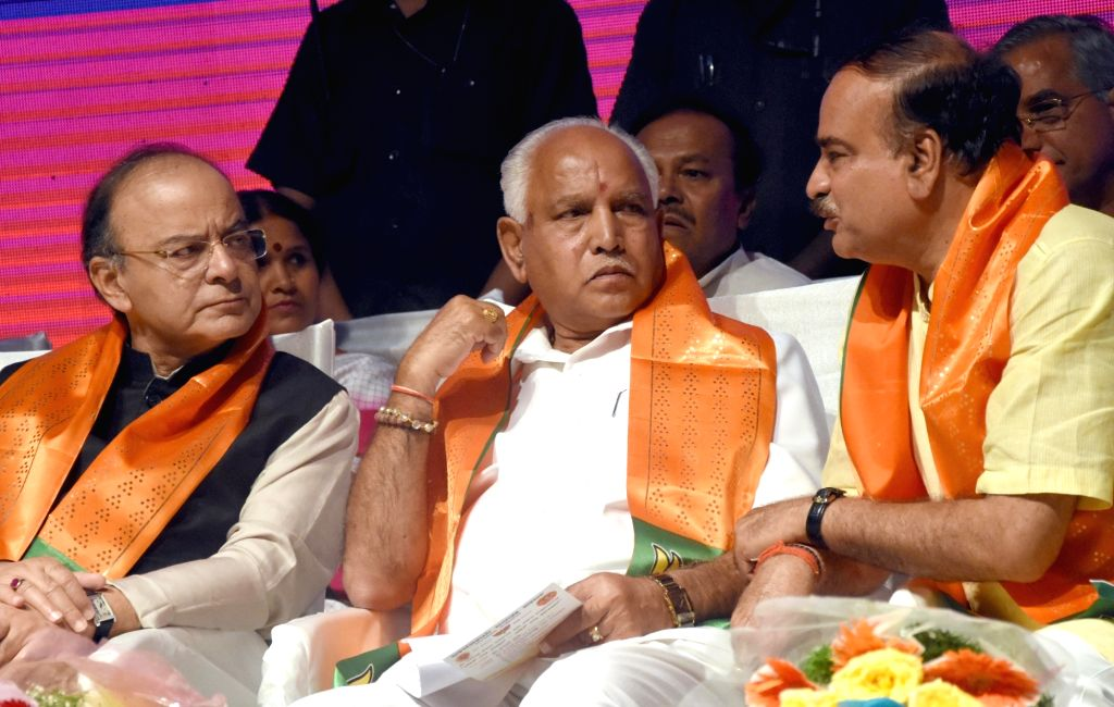 Union Ministers Arun Jaitley and Ananth Kumar with Karnataka BJP  chief B. S. Yeddyurappa during a programme organised to celebrate three years of the NDA Government in Bengaluru on May ... - Ministers Arun Jaitley and Ananth Kumar