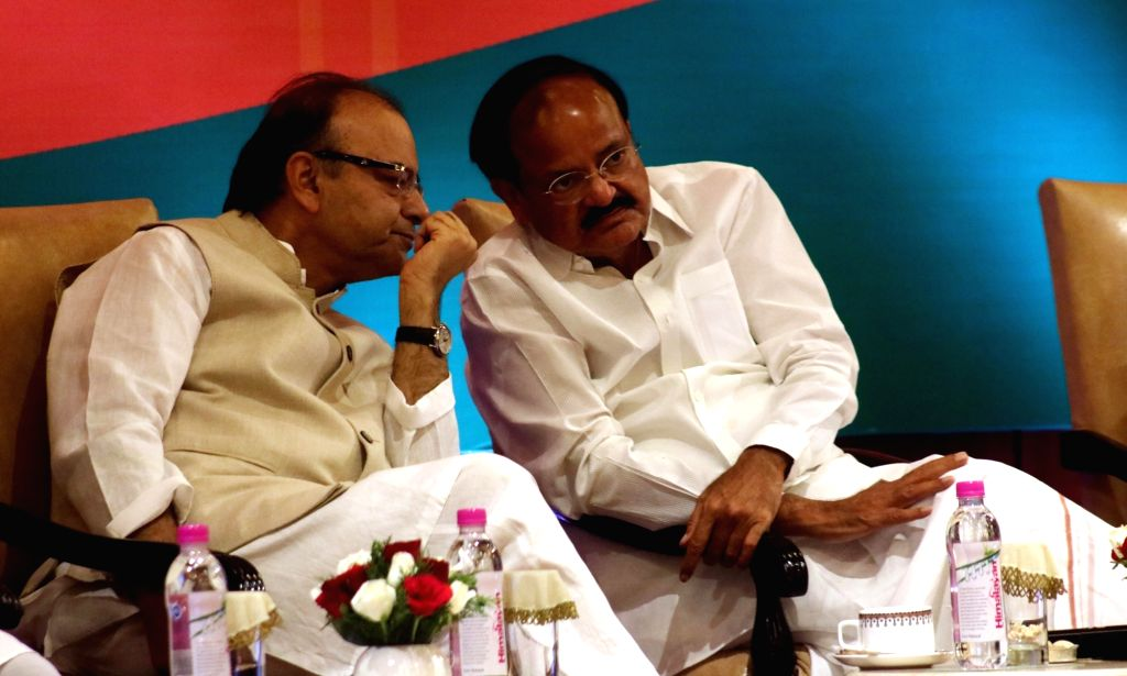 Union Ministers Arun Jaitley and M Venkaiah Naidu during a programme organised to interact with journalists regading the achievements of NDA government in last two years, in New Delhi on ... - Ministers Arun Jaitley and M Venkaiah Naidu