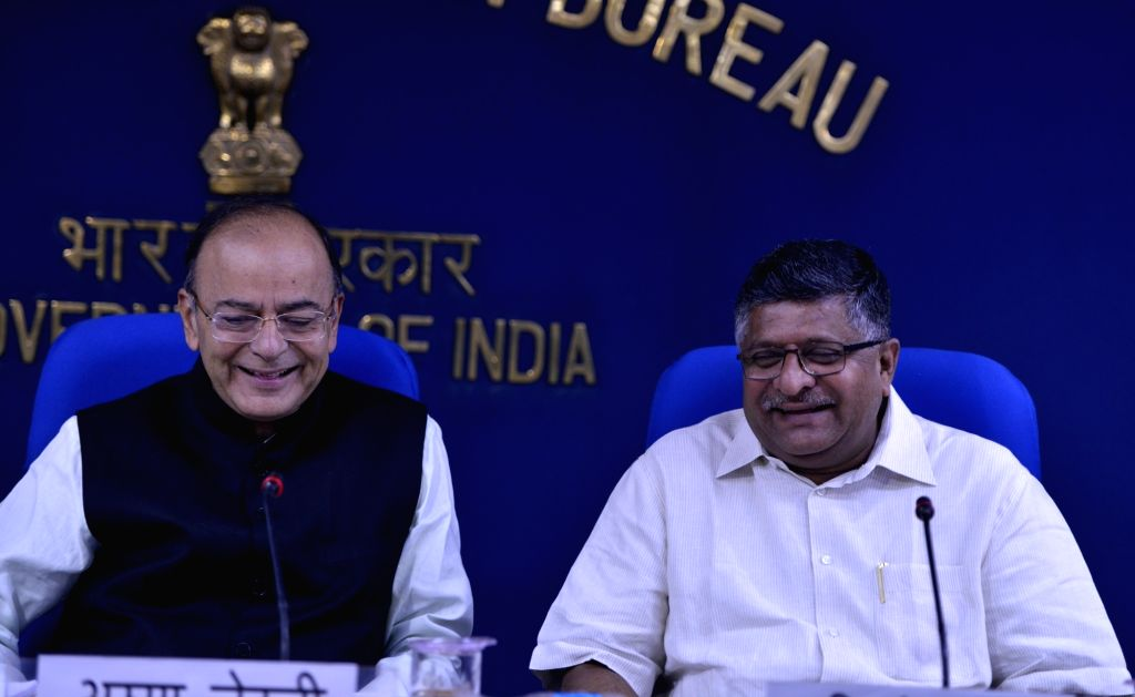 Union Ministers Arun Jaitley and Ravi Shankar Prasad at a press conference in New Delhi on Aug. 16, 2017. - Ministers Arun Jaitley and Ravi Shankar Prasad