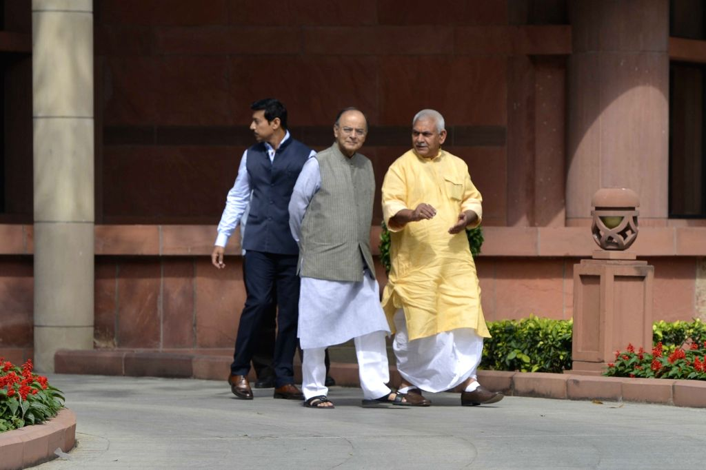 Union Ministers Arun Jaitley, Rajyavardhan Singh Rathore and Manoj Sinha leave after attending the BJP Parliamentary party meeting at Parliament house library, in New Delhi on March 16, ... - Ministers Arun Jaitley, Rajyavardhan Singh Rathore and Manoj Sinha