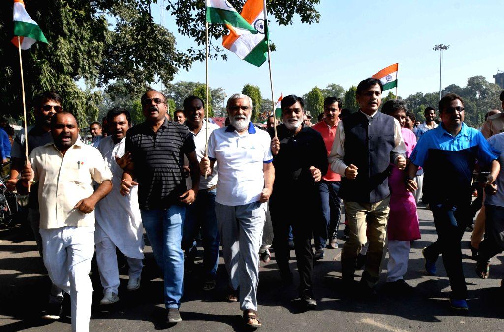 Union Ministers Ashwini Choubey and Ram Kripal Yadav participate in Run for Unity on Rashtriya Ekta Diwas in Patna on Oct 31, 2018. - Ashwini Choubey and Ram Kripal Yadav
