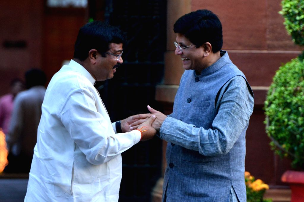 Union Ministers Dharmendra Pradhan and Piyush Goyal after attending the first cabinet meeting, at South Block in New Delhi, on May 31, 2019. - Dharmendra Pradhan and Piyush Goyal