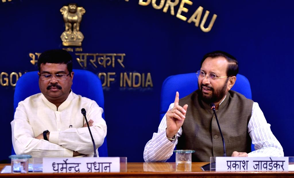 Union Ministers Dharmendra Pradhan and Prakash Javadekar during a press conference after a cabinet meeting, in New Delhi on Sep 3, 2019. - Dharmendra Pradhan and Prakash Javadekar