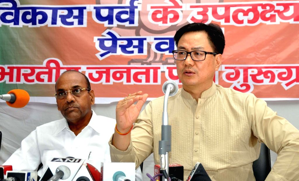 Union Ministers Kiren Rijiju and Anant Geete during a press conference regarding achievement of the Narendra Modi's government in Gurgaon on May 31, 2016. - Kiren Rijiju, Anant Geete and Narendra Modi