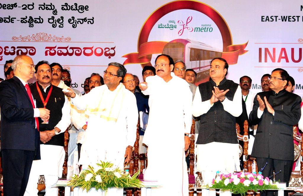 Union Ministers M. Venkaiah Naidu, Ananth Kumar and Karnataka Chief Minister Siddaramaiah at the inauguration of Magadi Road to Mysore Road East Metro line in Bengaluru on Nov. 16, 2015. - Karnataka Chief Minister Siddaramaiah, M. Venkaiah Naidu and Ananth Kumar