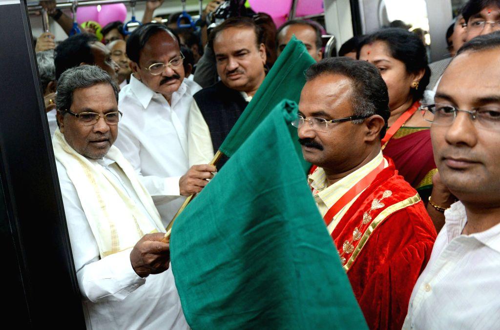 Union Ministers M. Venkaiah Naidu, Ananth Kumar and Karnataka Chief Minister Siddaramaiah flag off the Magadi Road to Mysore Road East Metro line in Bengaluru on Nov. 16, 2015. - Karnataka Chief Minister Siddaramaiah, M. Venkaiah Naidu and Ananth Kumar