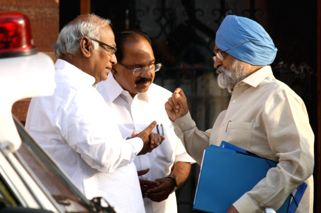 Union Ministers Mallikarjun Kharge and M Veerappa Moily with Deputy Chairman of Planning Commission, Montek Singh Ahluwalia after the last cabinet meeting of UPA-II government in New Delhi on May 13, - Mallikarjun Kharge, M Veerappa Moily and Montek Singh Ahluwalia