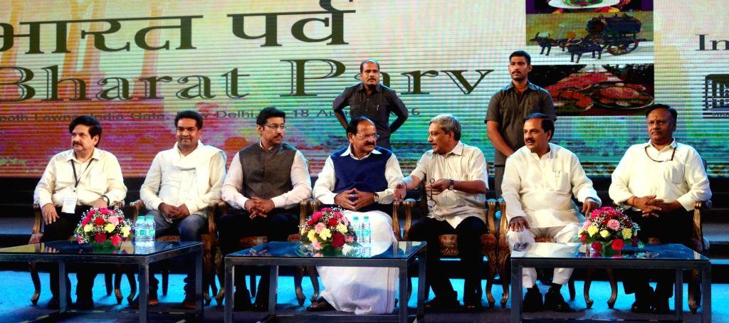 """Union ministers Manohar Parrikar, M. Venkaiah Naidu , Rajyavardhan Singh Rathore and Mahesh Sharma during the inauguration of """"Bharat Parv"""" at India Gate in New Delhi on Aug. 12, ... - M. Venkaiah Naidu, Rajyavardhan Singh Rathore and Mahesh Sharma"""