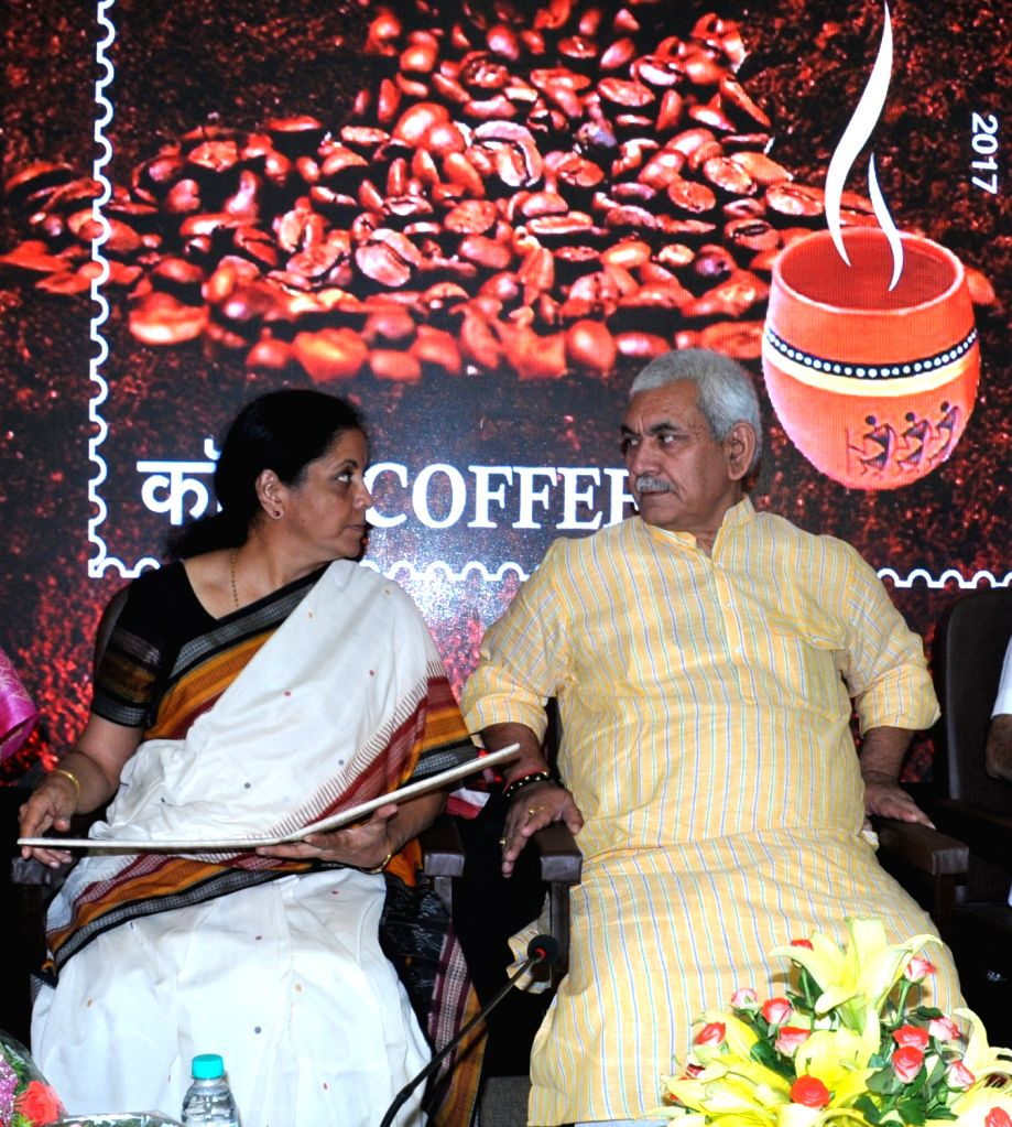 """Union Ministers Manoj Sinha and Nirmala Sitharaman during a programme organised to release """"Scented Stamp on Coffee"""" at GPO in Bengaluru on April 23, 2017. - Ministers Manoj Sinha and Nirmala Sitharaman"""