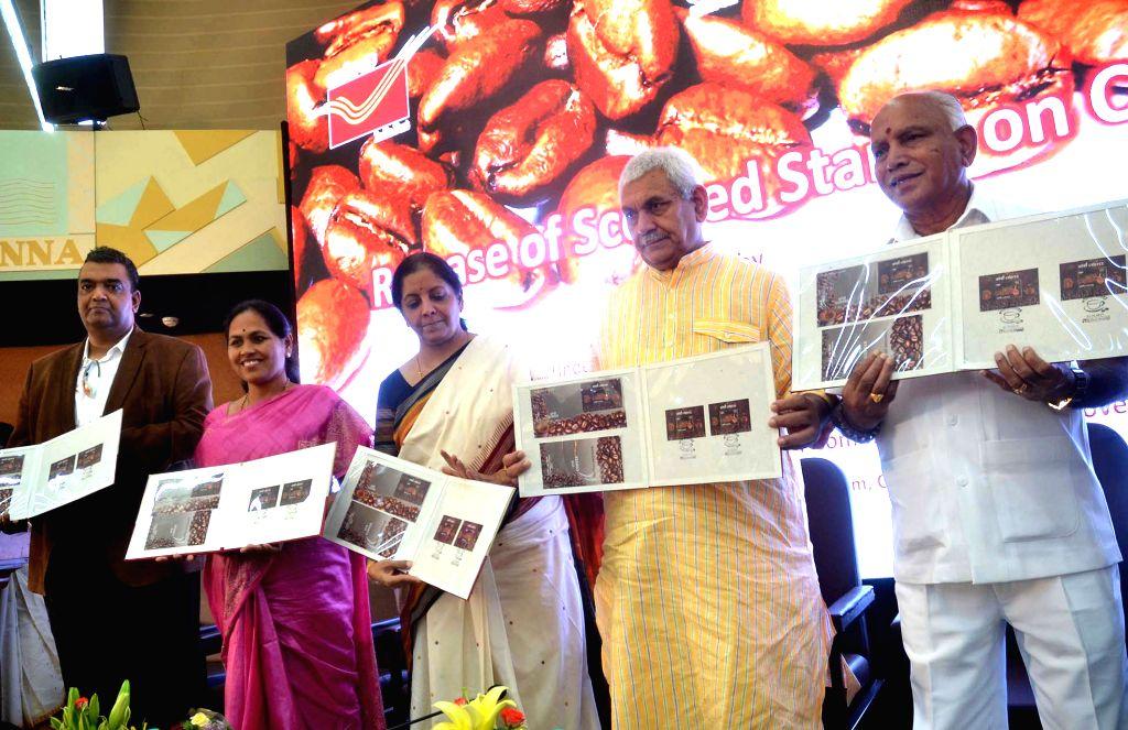 "Union Ministers Manoj Sinha and Nirmala Sitharaman with Karnataka BJP chief B. S. Yeddyurappa during a programme organised to release ""Scented Stamp on Coffee"" at GPO in ... - Ministers Manoj Sinha and Nirmala Sitharaman"
