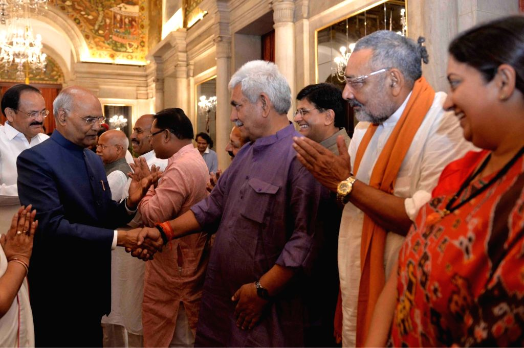 Union Ministers Manoj Sinha, Giriraj Singh and Smriti Irani greet President Ram Nath Kovind during a banquet hosted by the latter for the outgoing Union Council of Ministers led by Prime ... - Narendra Modi, Ministers Manoj Sinha, Giriraj Singh, Smriti Irani and Nath Kovind