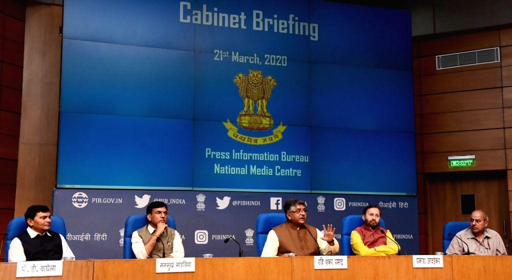 Union Ministers Mansukh L. Mandaviya, Ravi Shankar Prasad and Prakash Javadekar brief the media on various Cabinet decisions, in New Delhi on March 21, 2020. - Mansukh L. Mandaviya, Ravi Shankar Prasad and Prakash Javadekar