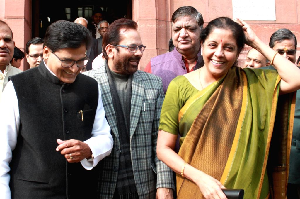 Union Ministers Nirmala Sitharaman and Mukhtar Abbas Naqvi with Smajwadi Party leader Ramgopal Yadav at Parliament in New Delhi on Nov 30, 2016. - Nirmala Sitharaman, Mukhtar Abbas Naqvi and Ramgopal Yadav