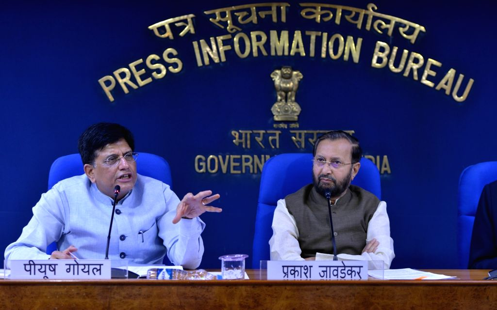 Union Ministers Prakash Javadekar and Piyush Goyal address a press conference in New Delhi on July 17, 2019. - Prakash Javadekar and Piyush Goyal