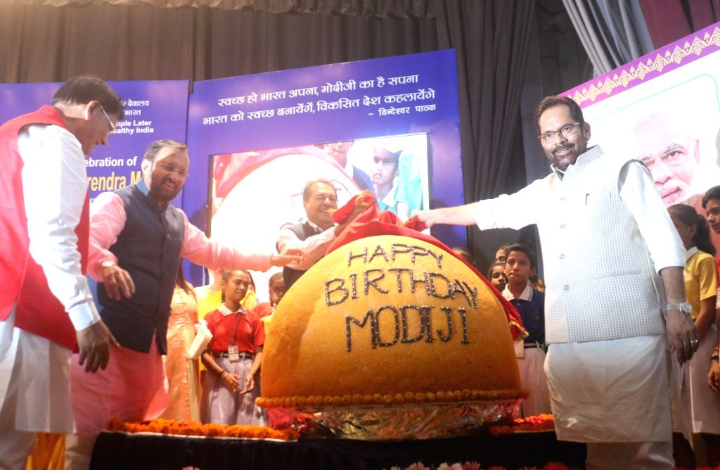 Union ministers Prakash Javdekar, Mukhtar Abbas Naqvi with Sulabh International founder Bindeshwar Pathak unveiled a 568 Kg laddu as part of celebration of Prime Minister Narendra Modi's 68th ... - Narendra Modi and Bindeshwar Pathak