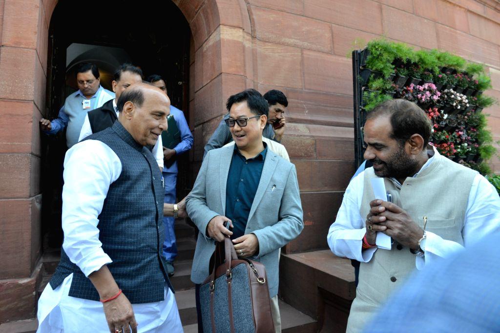 Union Ministers Rajnath Singh, Kiren Rijiju and BJP MP Ramesh Bhiduri at Parliament in New Delhi on March 18, 2020. - Ministers Rajnath Singh, Kiren Rijiju and B