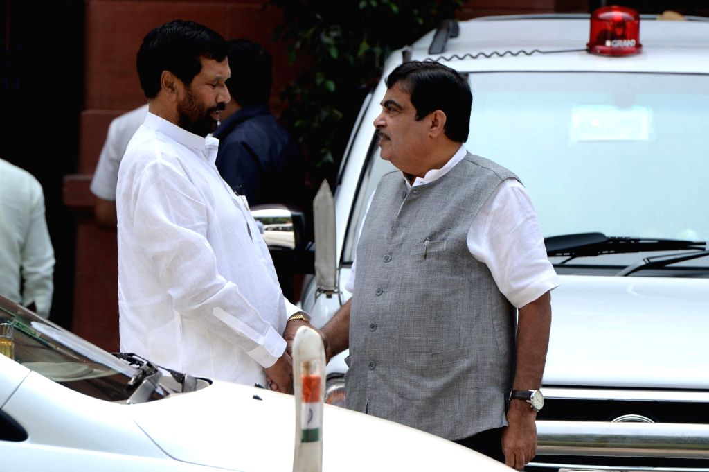 Union Ministers Ram Vilas Paswan and Nitin Gadkari come out after Cabinet Meeting at South Block in New Delhi on Sept 28, 2016. - Ram Vilas Paswan and Nitin Gadkari